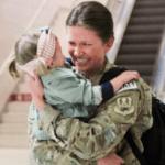Military Mom coming home hugging daughter