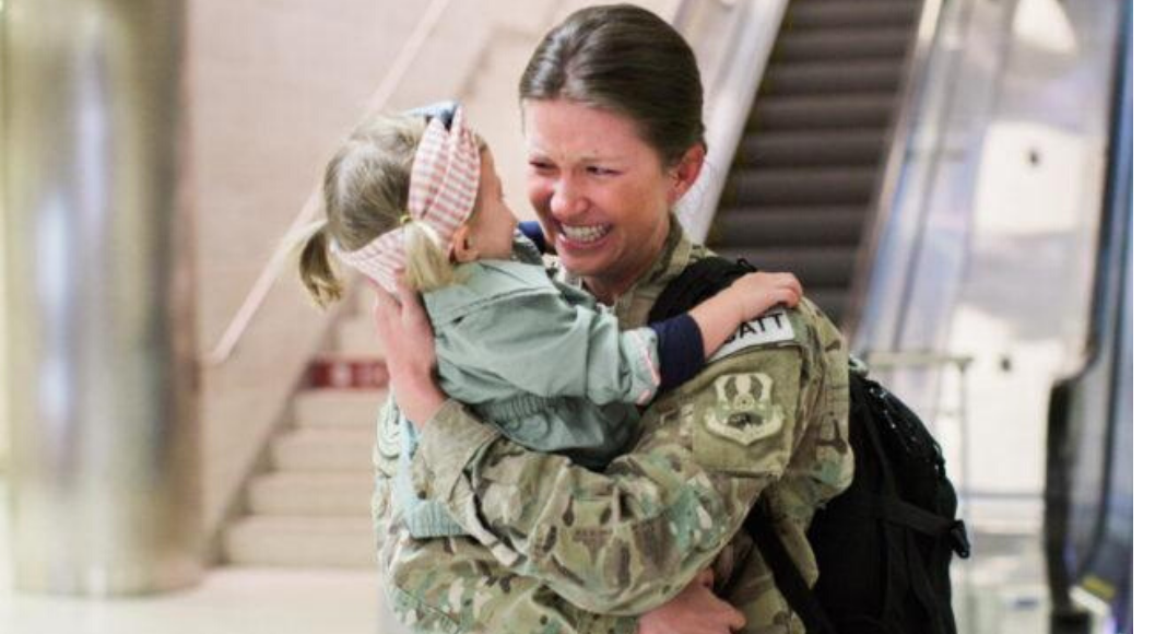 Military Mom coming home hugging daughter