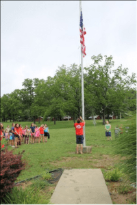 Raising the flag every morning of camp during Operation Military Support week gives military children a unique sense of pride for their country.