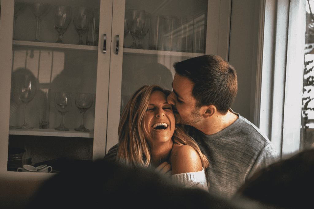 couple kissing and laughing