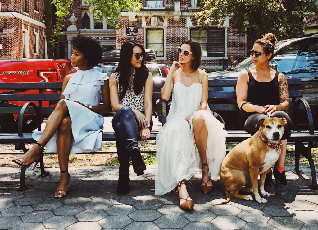 girlfriends on a bench