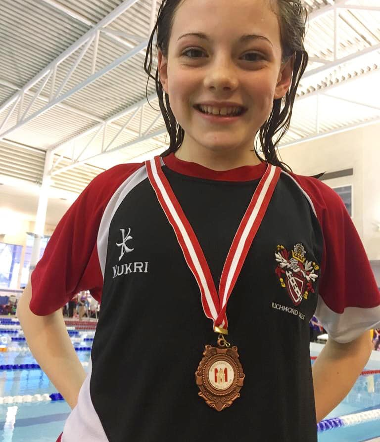 My daughter, Kathrynn, won a bronze medal in swimming.