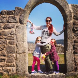 girls with mother in arch of castle ruins