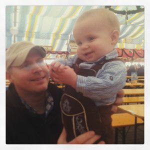 baby and father at festival in Germany