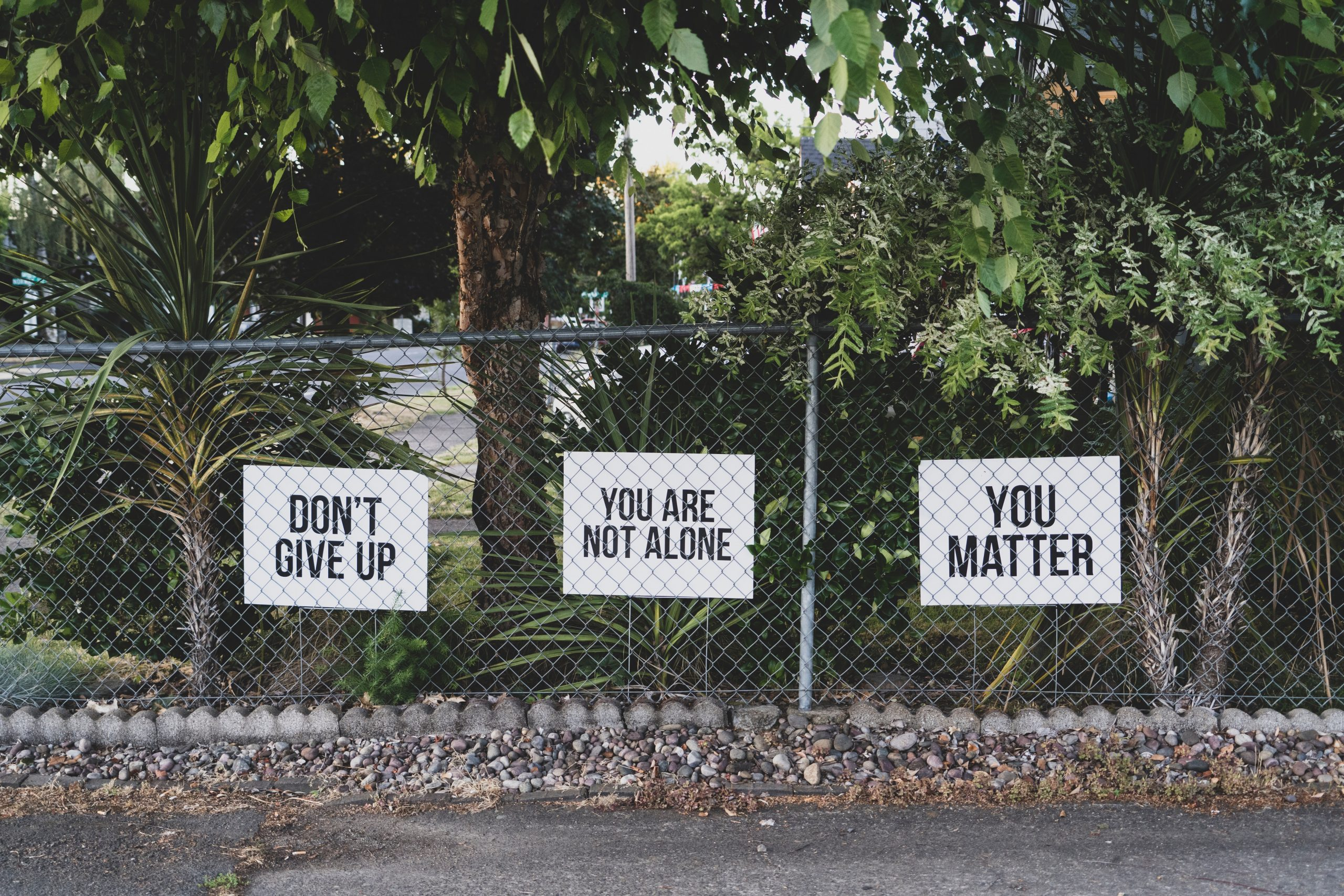 inspirational posters on fence