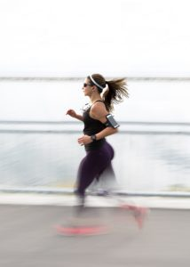 blurred image of woman running