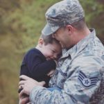 husband hugging child before deployment