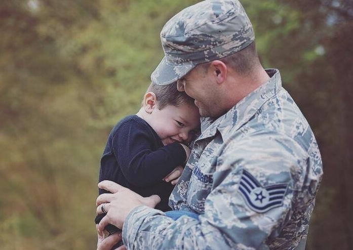 husband hugging child before deployment