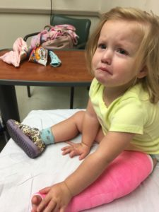 toddler in pink cast
