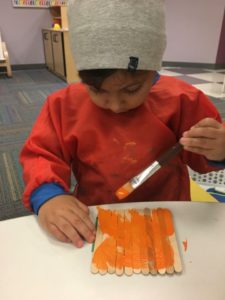 toddler painting in school