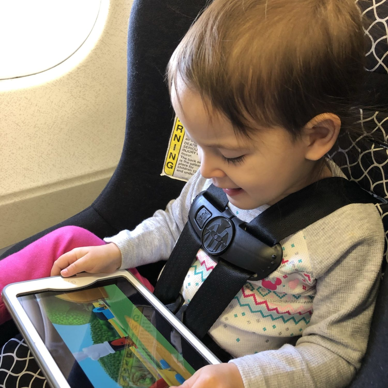 traveling with small child in car seat with iPad