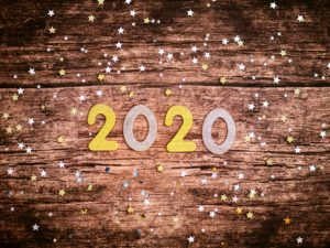 2020 new year graphic on wood with glitter