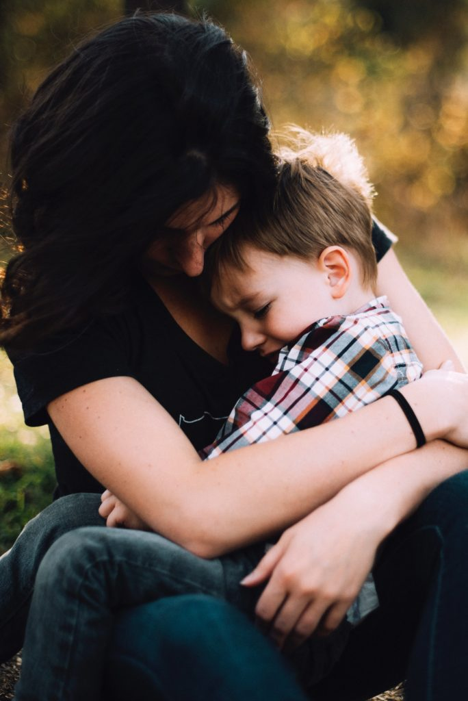 stable mother comforting child
