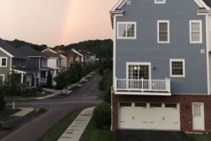 rainbow above house in neighborhood