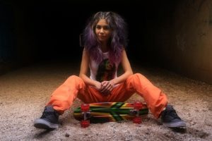 girl with purple hair and skateboard