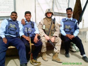 military member deployed with iraqi service members
