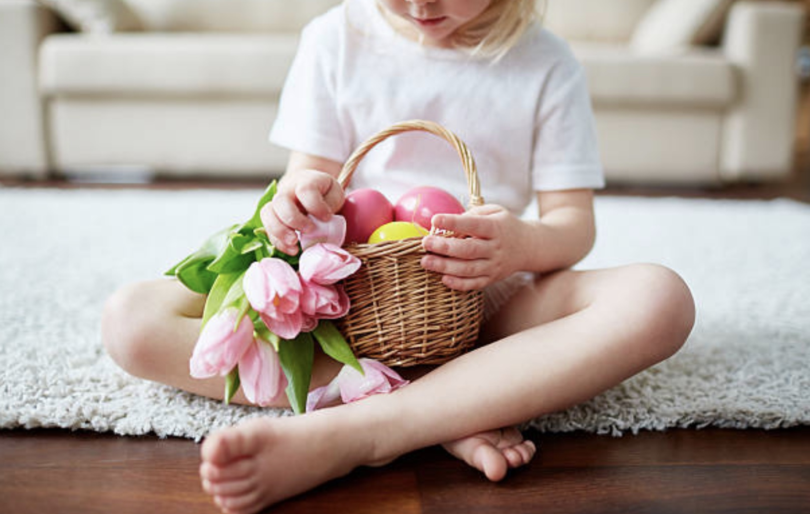 child holding easter basket with flowers