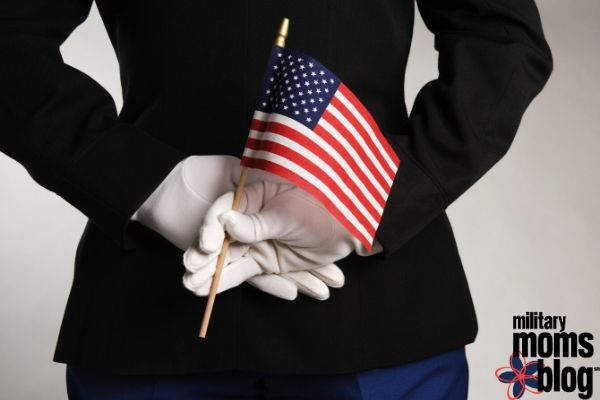 active-duty soldier with flag