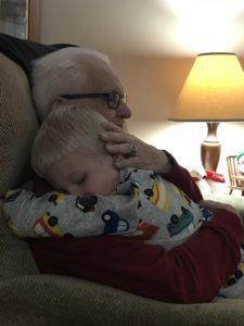 grandpa hugging child during last visit
