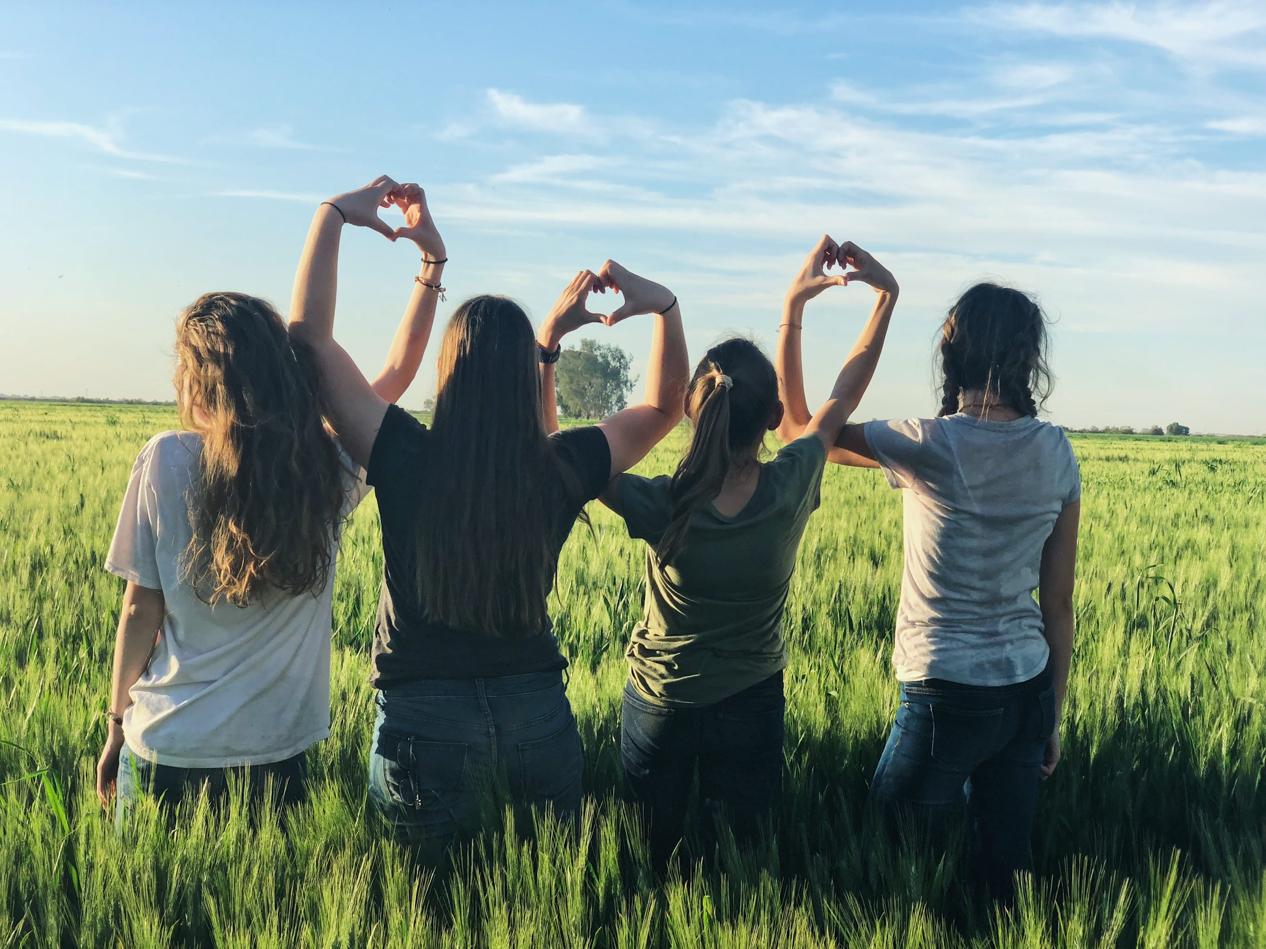 women standing together in a field