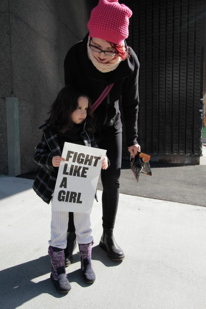 girl and mother at protest using voice