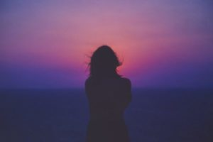 woman alone with purple night sky