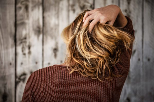 hair cut on woman with barn-style background