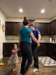 dancing in the kitchen of our house