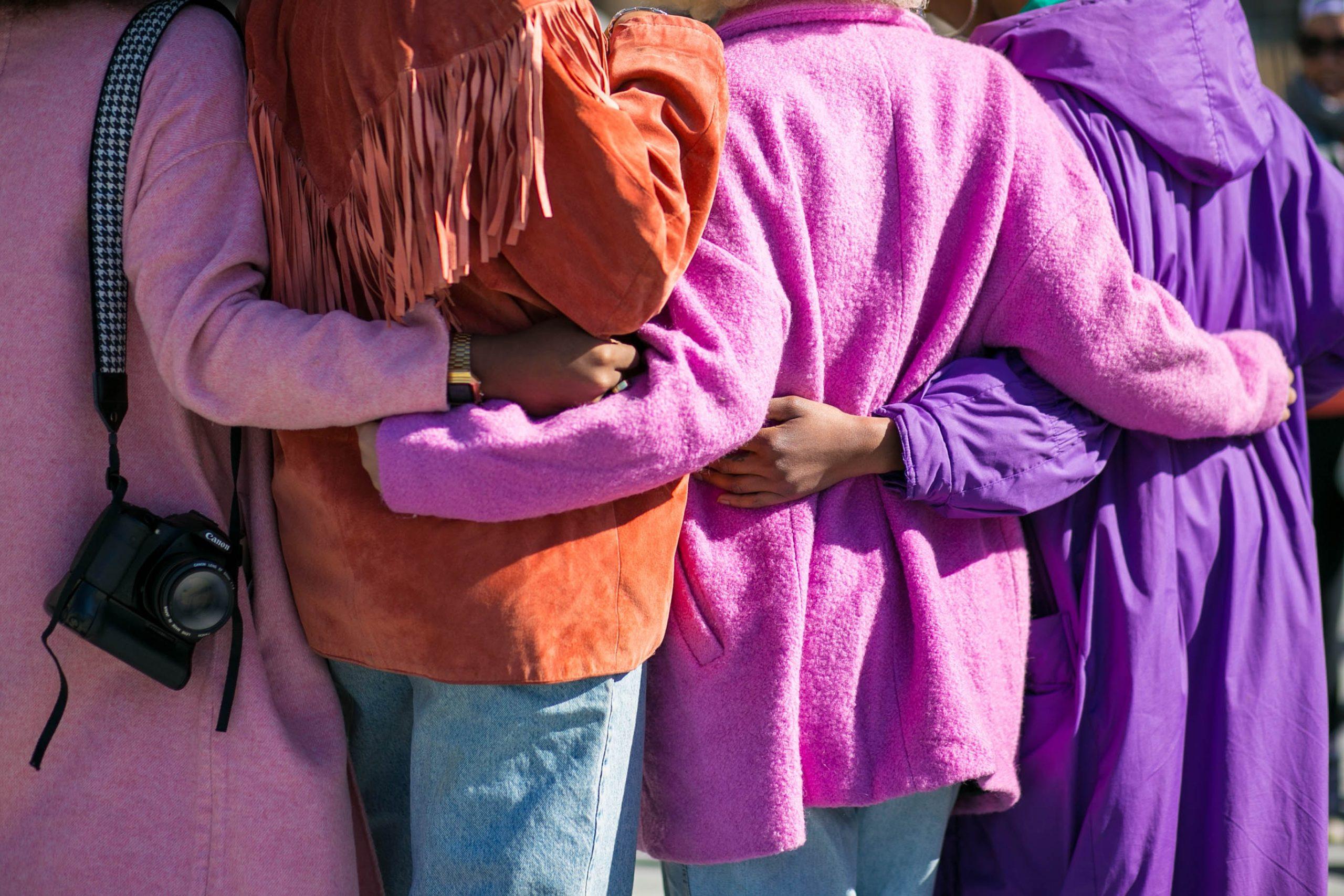 women hugging back view