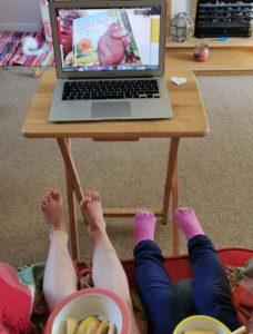 children watching show on laptop