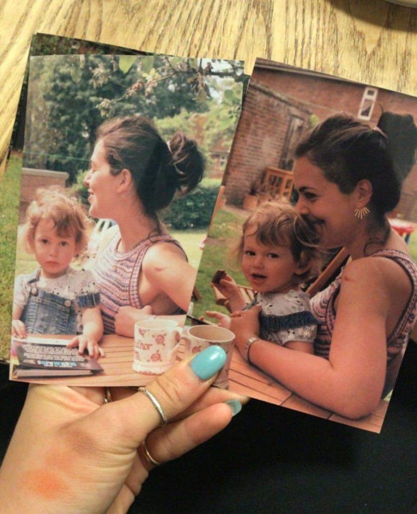 holding photos of memories