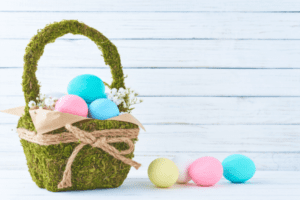 Green basket with multi-colored eggs