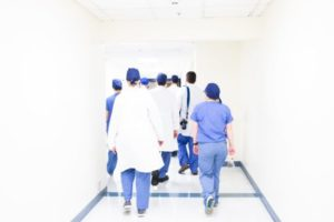 doctors in white hallway of hospital