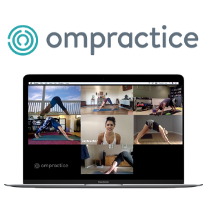 A computer with many people doing yoga on the screen with personal instruction from the yoga teacher