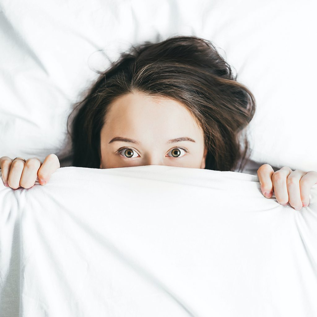 woman not sleeping in bed