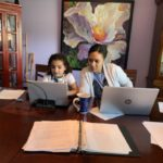 mom and daughter working from home