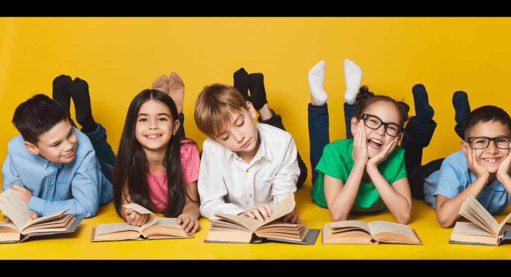 children reading on ground with yellow background