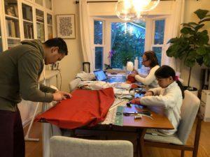 family making masks at table