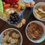 snack tray with different fruits, veggies, meats, and crackers