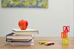 teacher supplies on desk