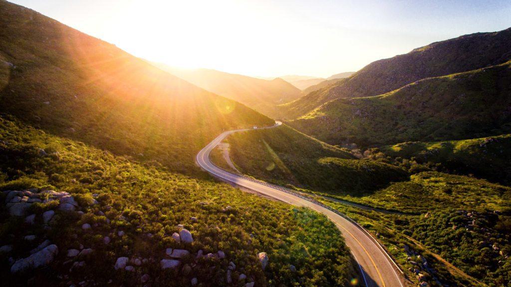 winding road or journey in california golden hour