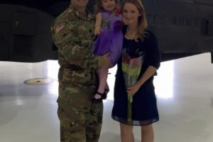 military couple with child