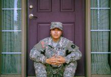 American soldier sitting on doorstep