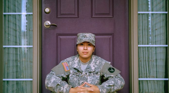 American soldier sitting on doorstep
