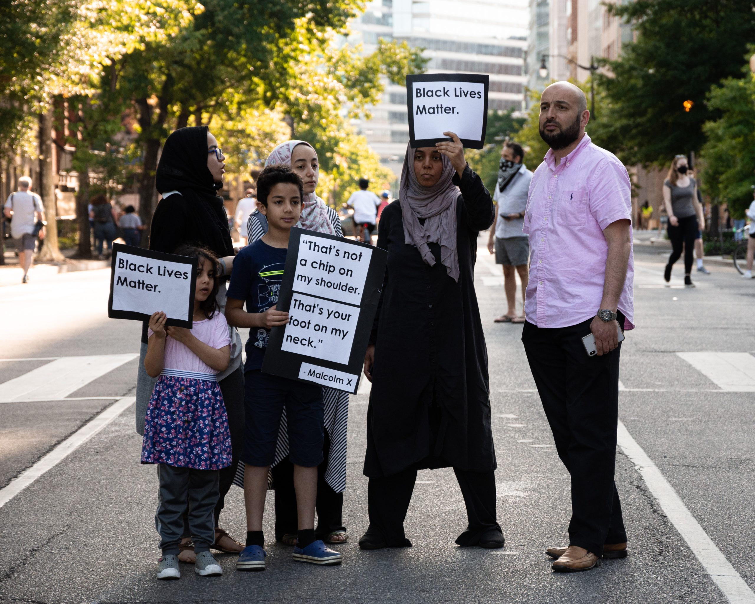 Arabic family with signs at a black lives matter protest