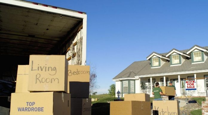 moving boxes and truck outside house