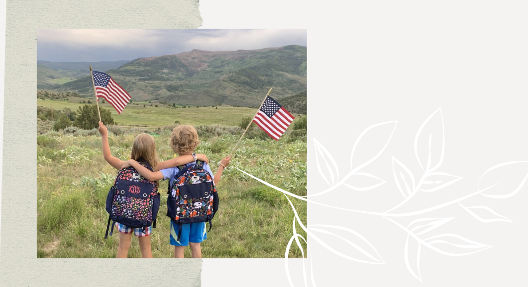 Wanderwild backpacks on kids with flags