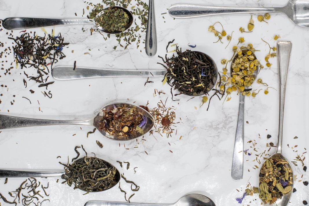 loose-leaf tea on spoons