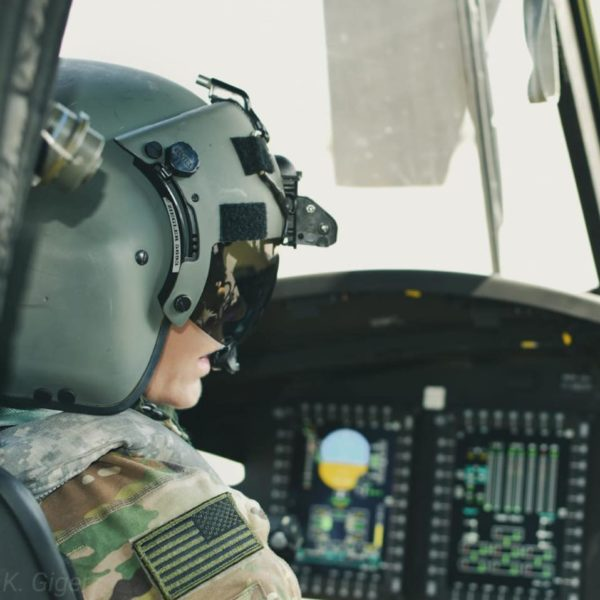 Woman flying military helicopter