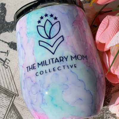 A beautiful watercolor wine tumbler with The Military Mom Collective logo